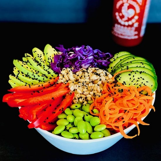 Asian Buddha Bowl with Siracha Sauce in the Background