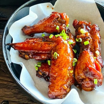 chicken-wings-on-plate-covered-in-wing-sauce
