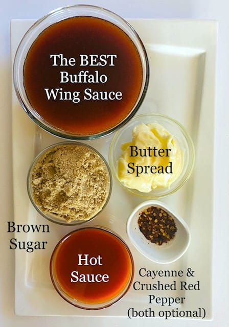 wing-sauce-in-bowl-and-all-ingredients-in-separate-bowls-brown-sugar-butter-hot-sauce-cayenne-crushed-red-pepper