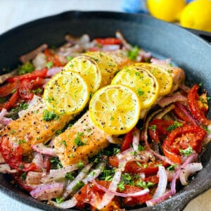 Easy-Baked-Salmon-in-skillet-lemon-in-background