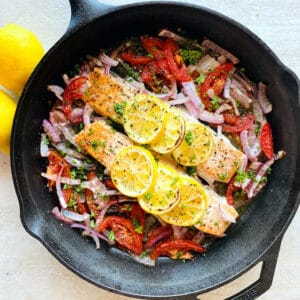 Easy-Baked-Salmon-in-skillet-next-to-lemon