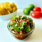 Salsa-in-bowl-with-chips-lime-and-tomato
