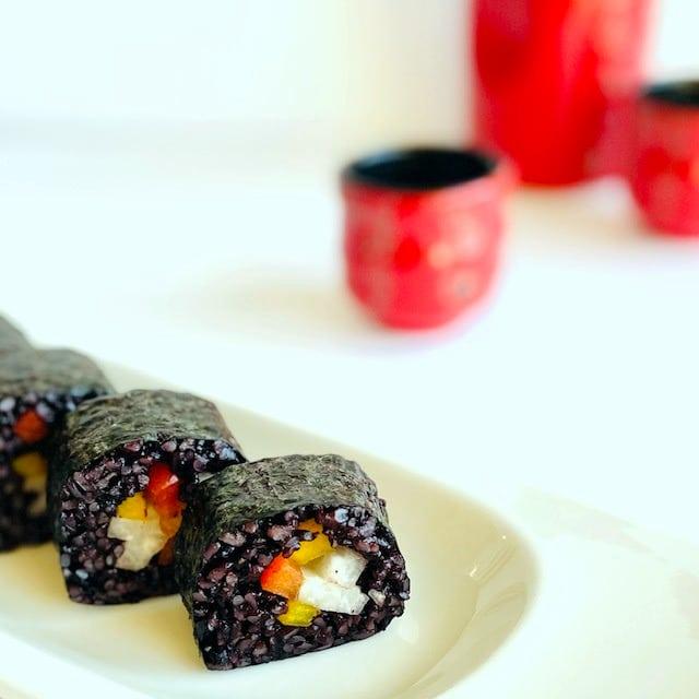black-rice-sushi--red-sake-glass