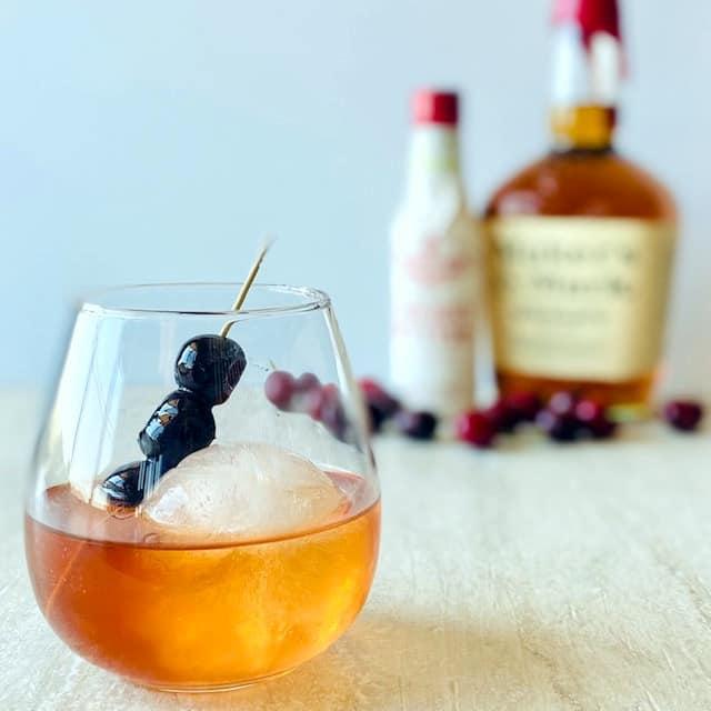 cherry-manhattan-in-glass-with-cherry-garnish-and-round-shape-ice