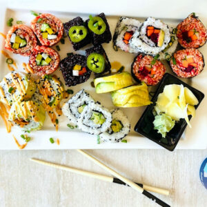 vegetable-sushi--different-kinds-on-plate-next to chopsticks