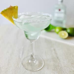 rum margarita with lime in background