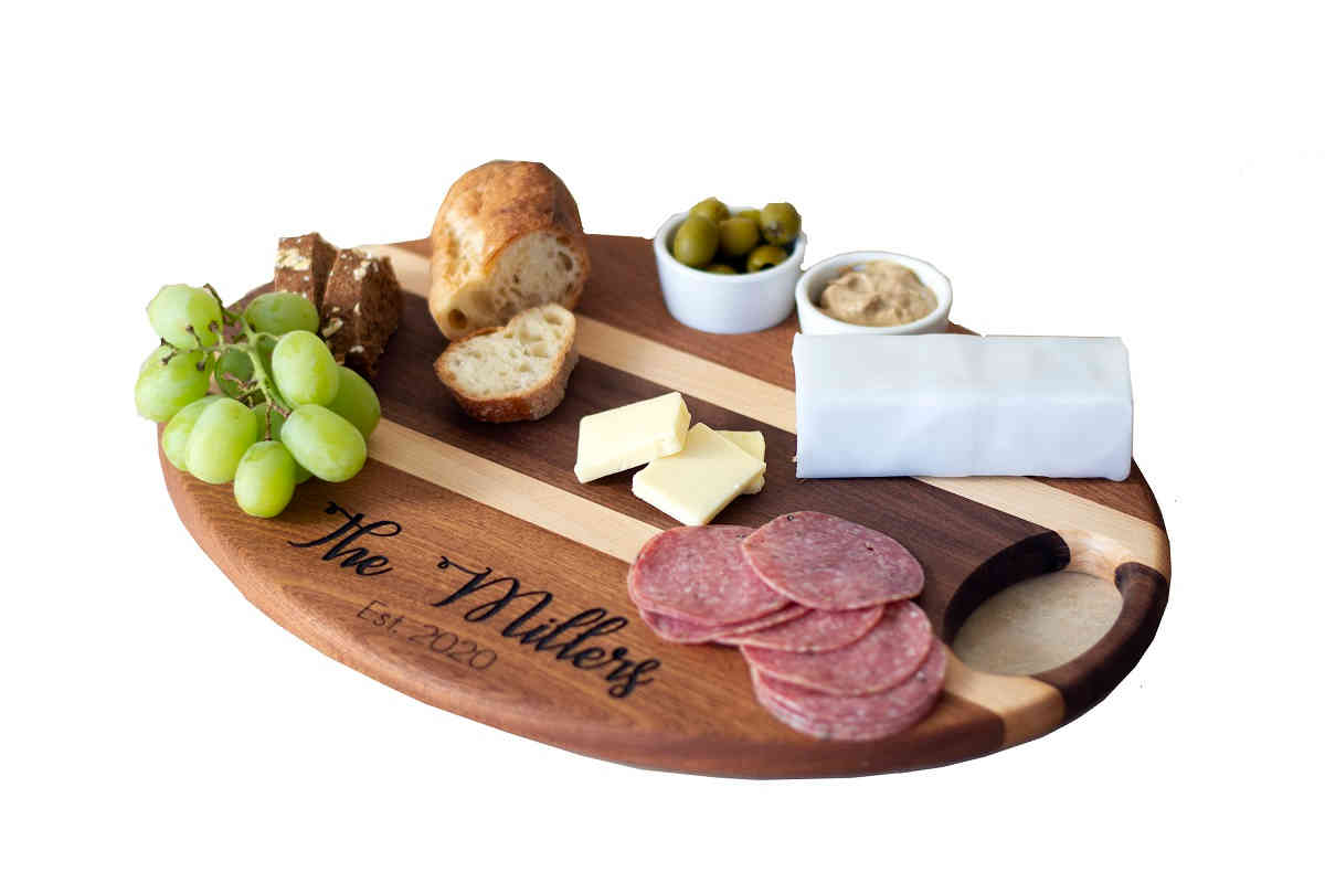 cheese board with meats, cheeses, grapes and olives