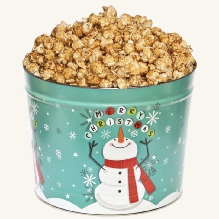 holiday tin filled with caramel popcorn