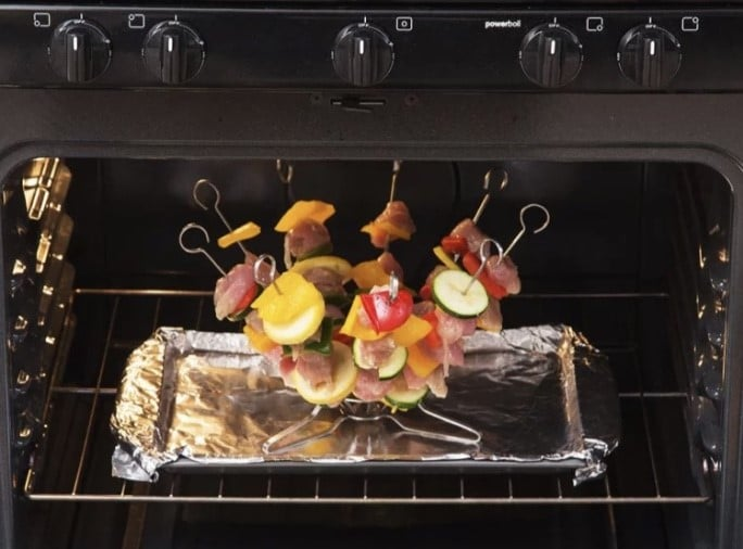 o-yaki skewer set with meat and vegetables on each skewer in the oven