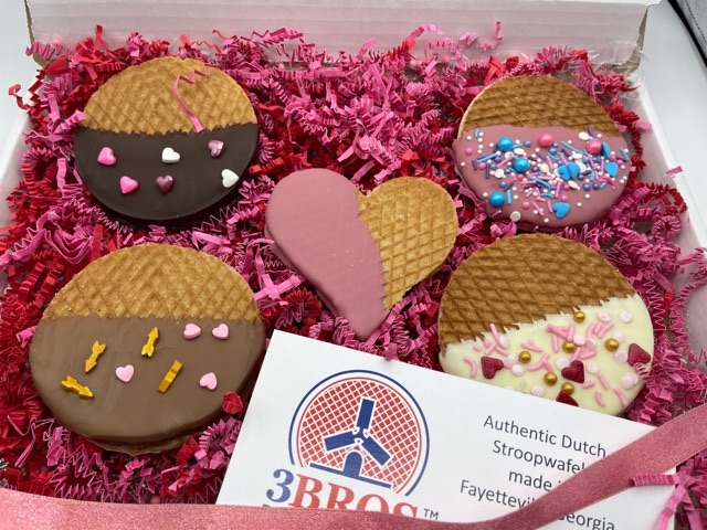 a box of different color 3 bros stroopwafels