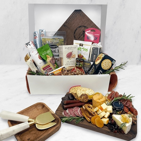 my charcuterie board box with meats and cheese and arranged board