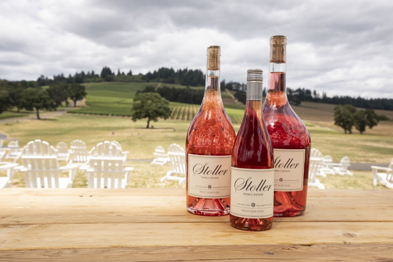 stoller estate rose with vineyard in background