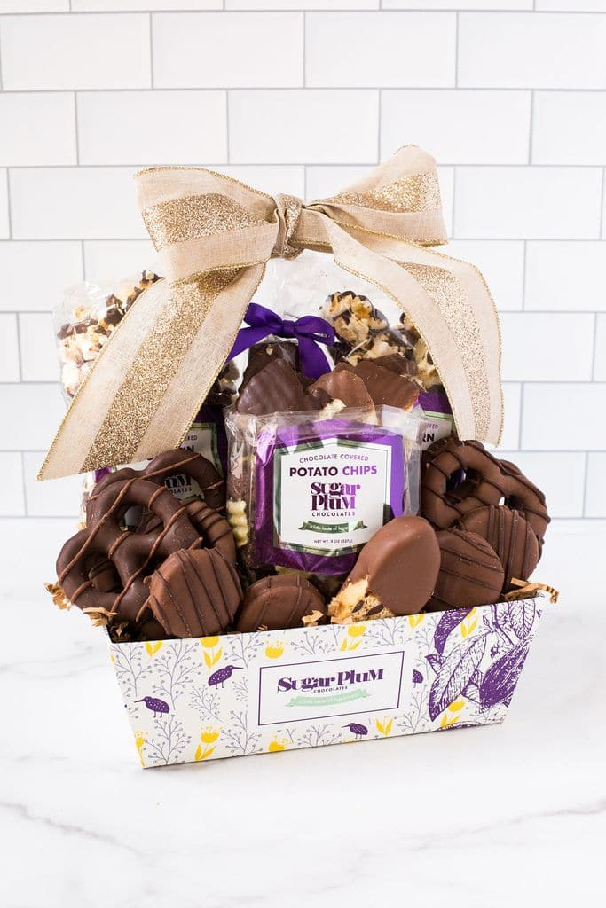 a variety of chocolate covered confections in a gift basket