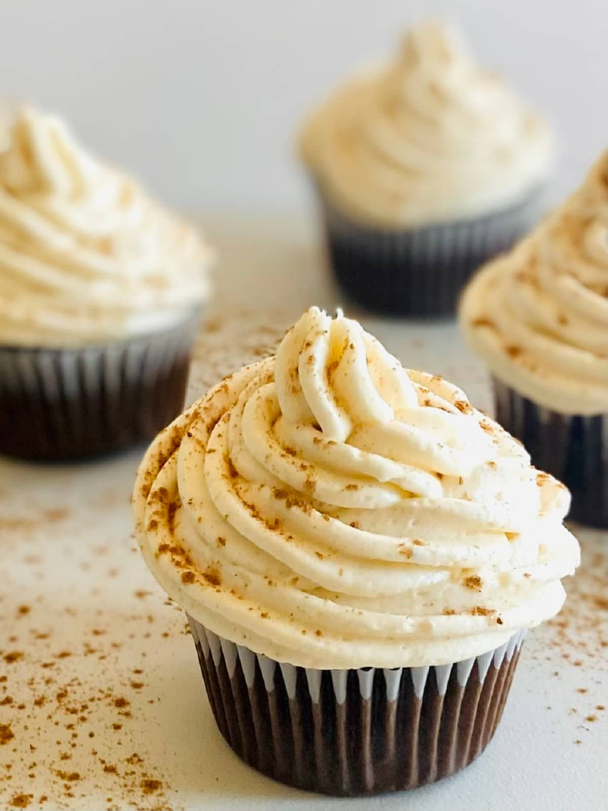four chocolate cupcakes with cream cheese frosting no butter
