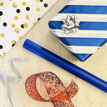 present, wrapping paper and ribbons