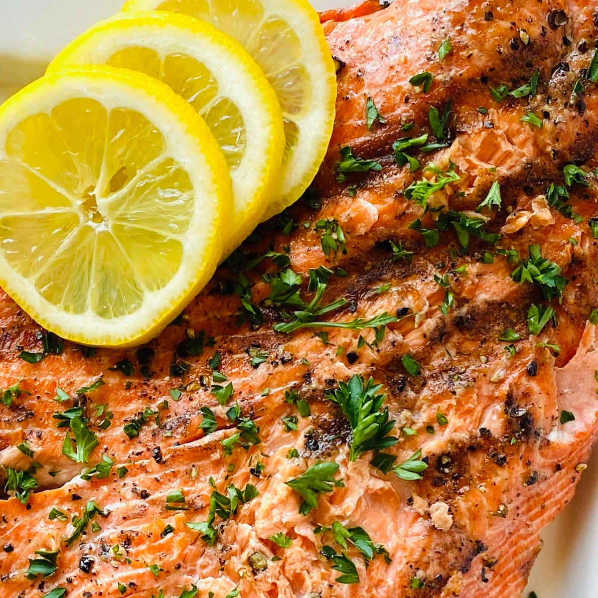 grilled wild caught sockeye salmon garnished with lemon and parsley