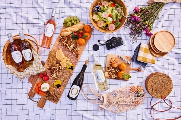 a picnic spread with food and olema wines