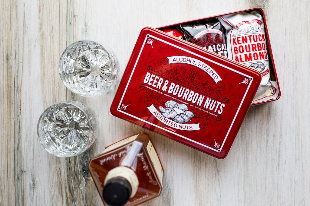 sugar plum beer boubon nuts next to 2 cocktail glasses