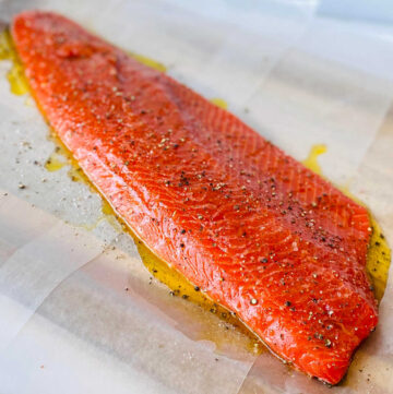 wild caught sockeye salmon covered with olive oil salt and pepper