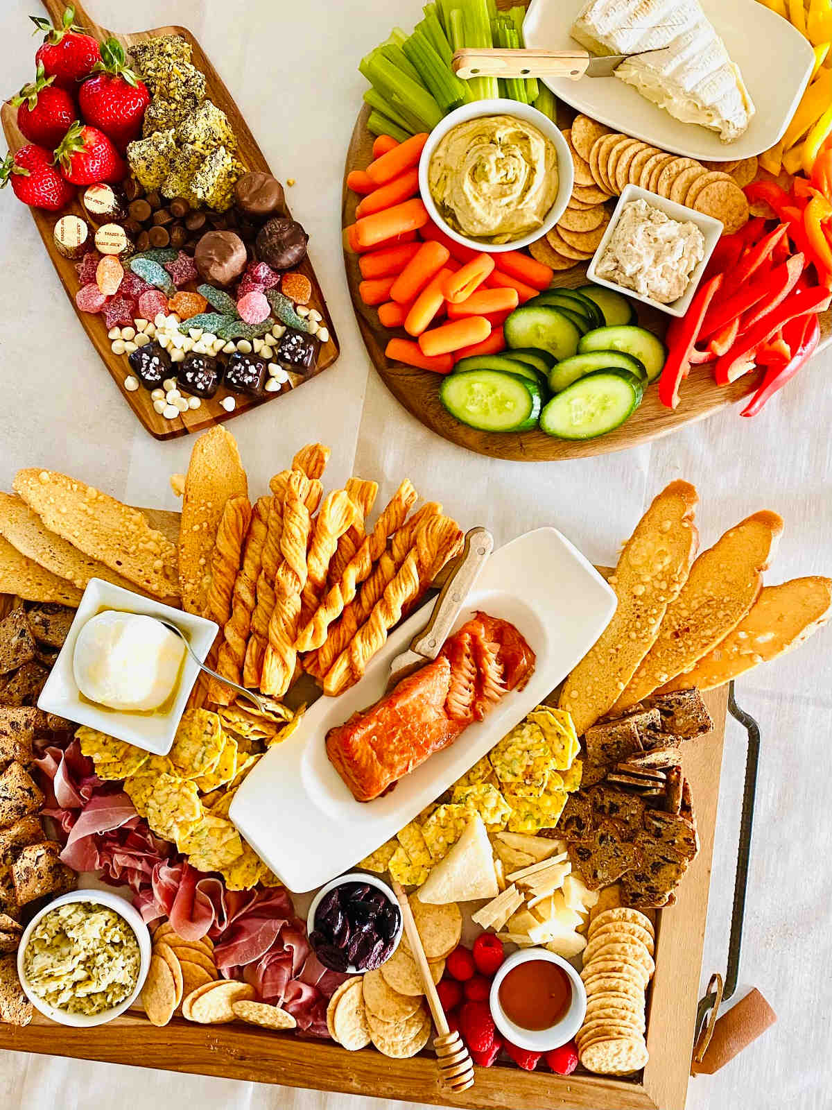 Vegetarian charcuterie board, desert charcuterie board and trader joe's cheese and meat board