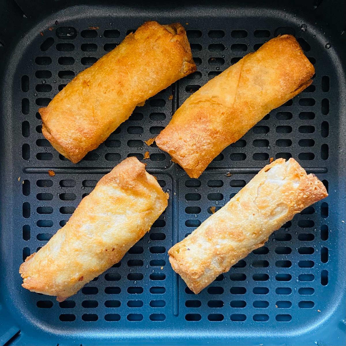 cooked frozen egg rolls in air fryer basket