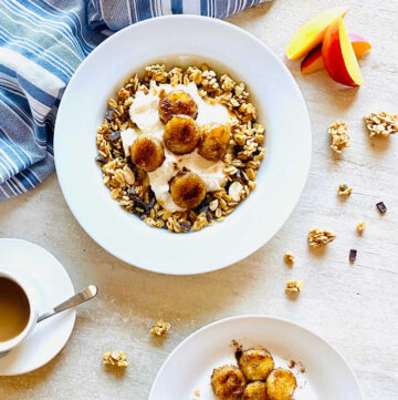 air fried bananas in a bowl with yogurt and granola next to bananas and nectarines