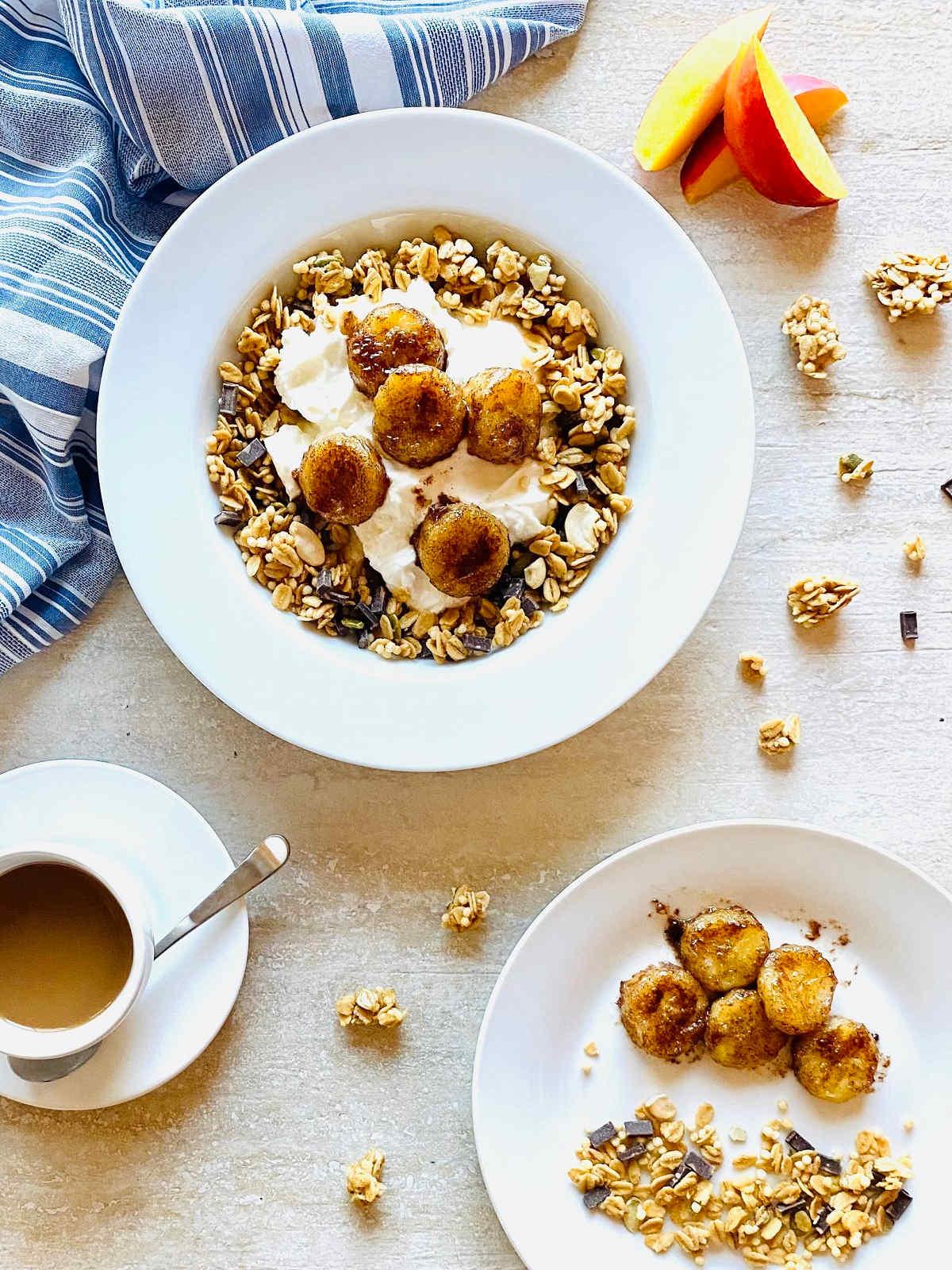 air fryer bananas in a bowl with yogurt and granola next tonectarines