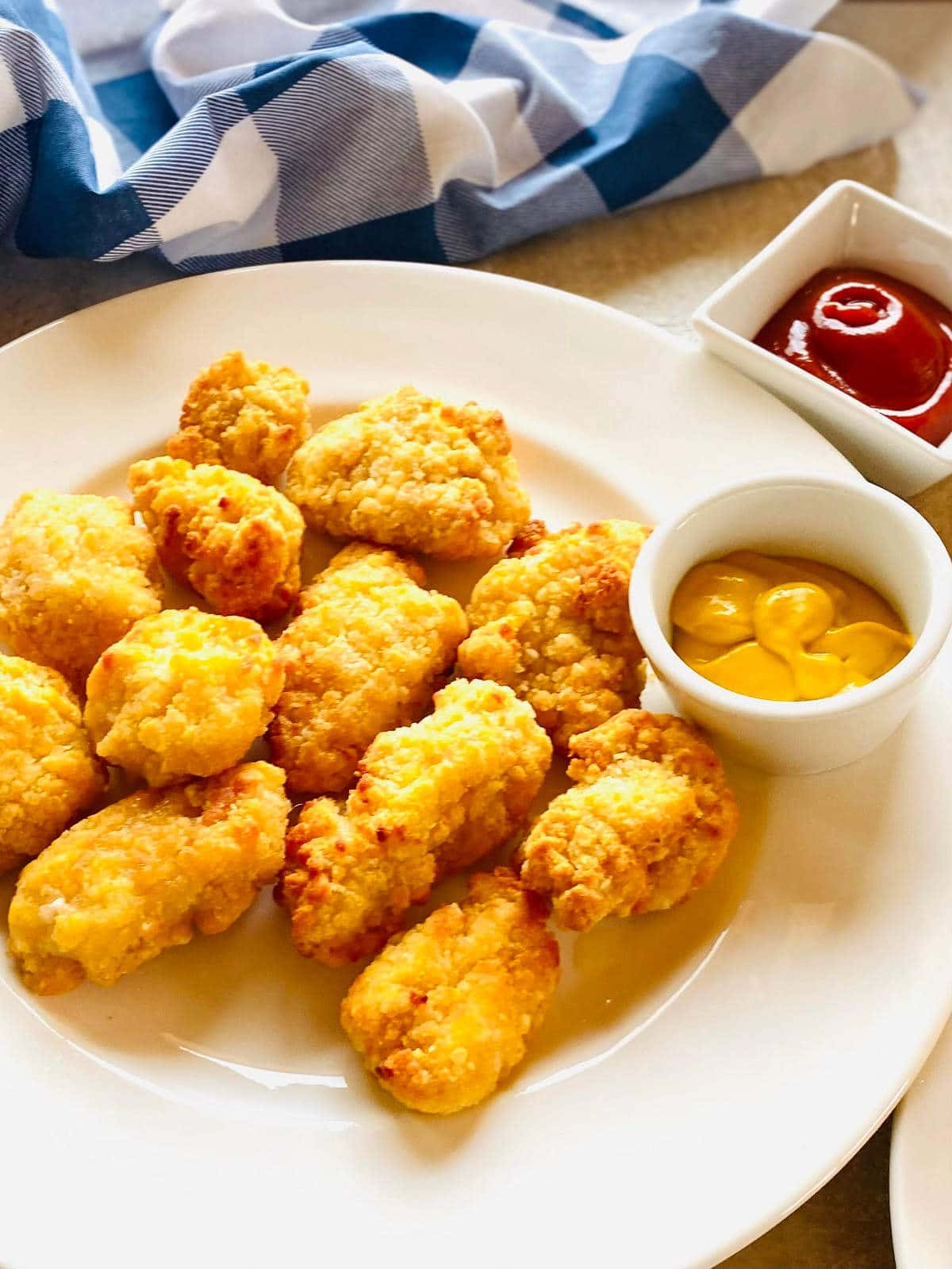 air fryer frozen chicken nuggets on ap plate with dipping sauce